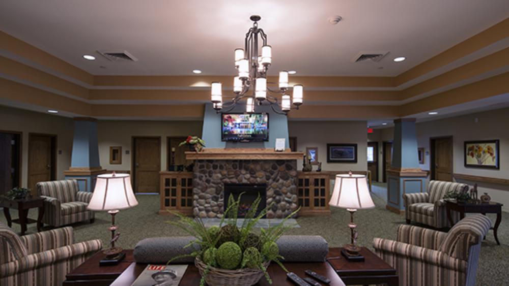 Living room at Oxford Glen Memory Care at Grand Prairie