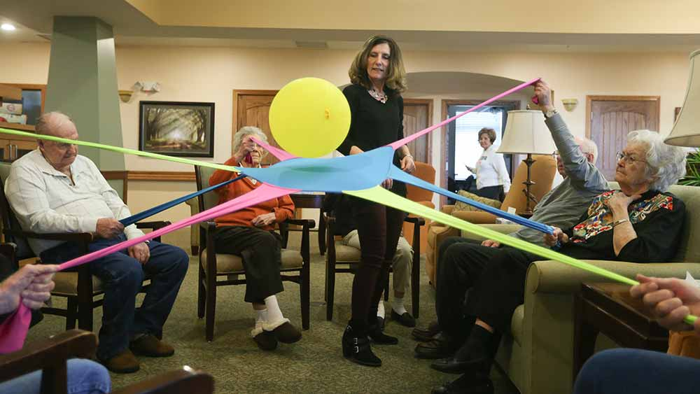 Variety of activities at Glen Carr House Memory Care in Derby, Kansas