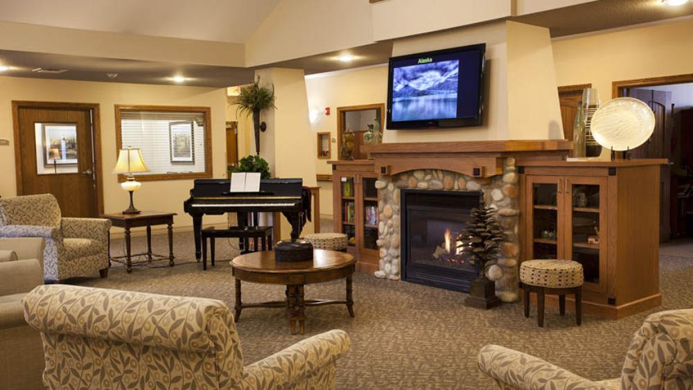 Lounge with fire place at Glen Carr House Memory Care in Derby, KS