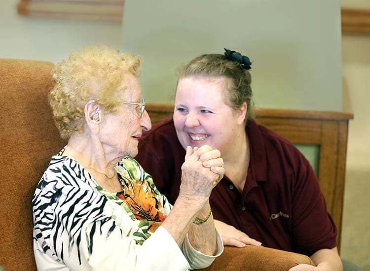 Resident enjoying time with Glen Carr House Memory Care caretaker