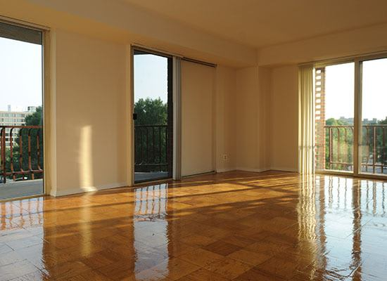 Spacious living room with shiny wood floors at Capitol Park Plaza & Twins