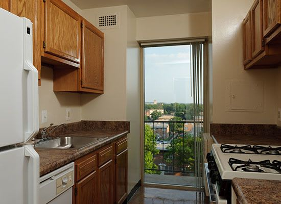 Fully equipped kitchen at Capitol Park Plaza & Twins