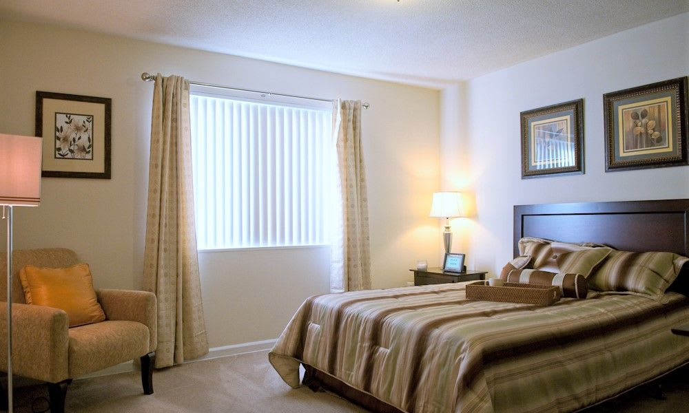 Well decorated bedroom at Park Forest Apartments in Oxon Hill