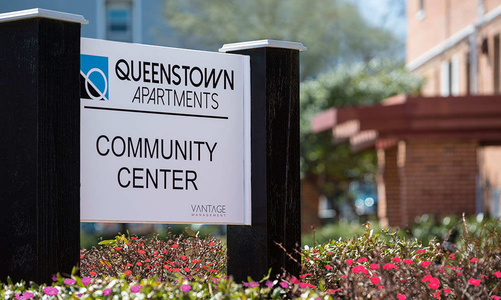 Community Center Sign At Queenstown Apartments