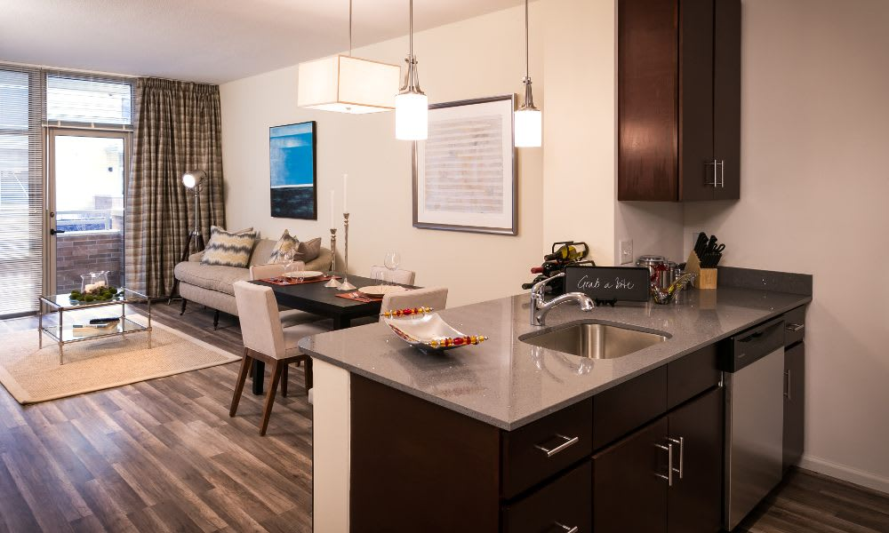Kitchen, dining area and living room at The Premier in Silver Spring