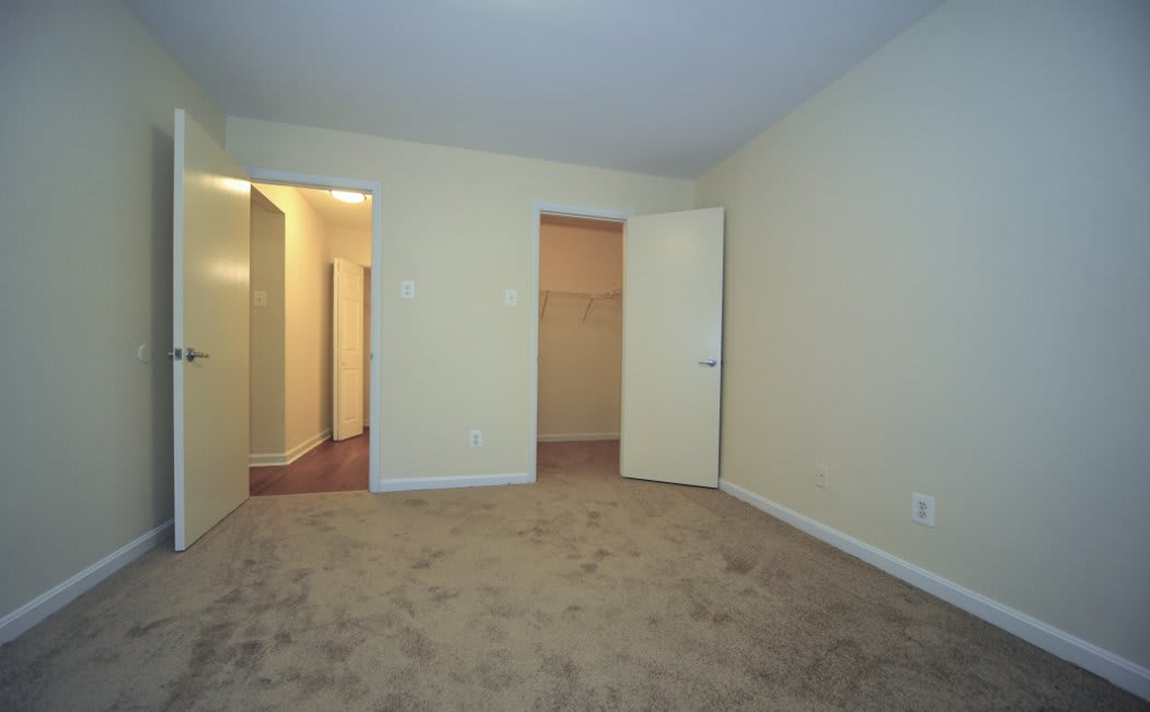 Bedroom and walk-in closet at Washington Apartments in Washington
