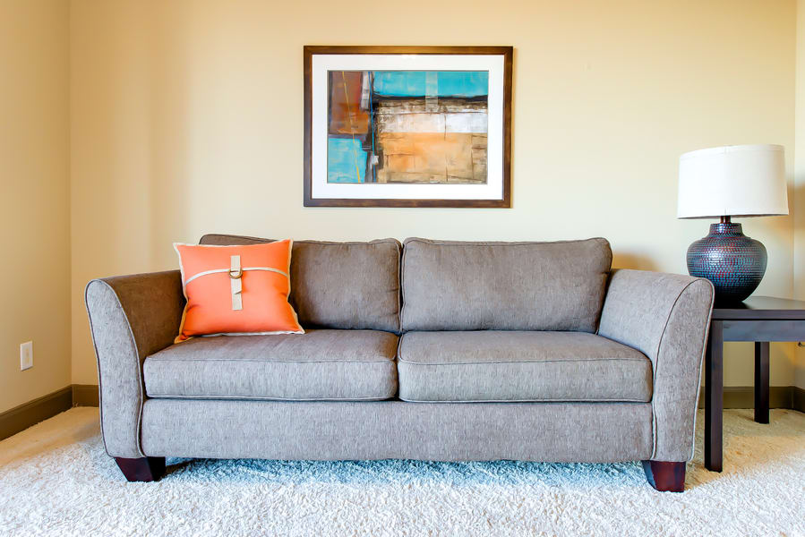 Couch in the middle of the living room in a CWS Home Services home