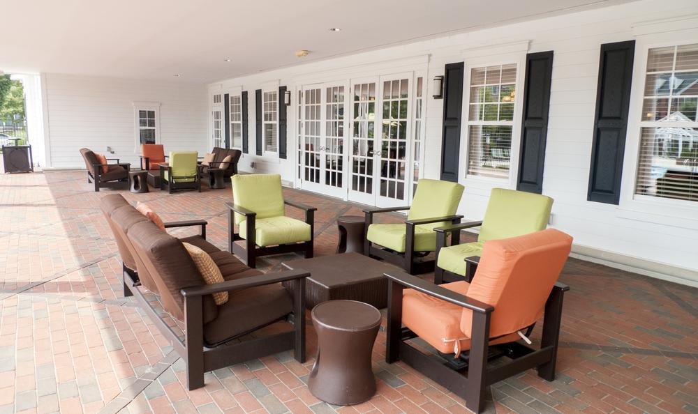 clubhouse outdoors meeting area at The Flats at West Broad Village in Glen Allen, VA