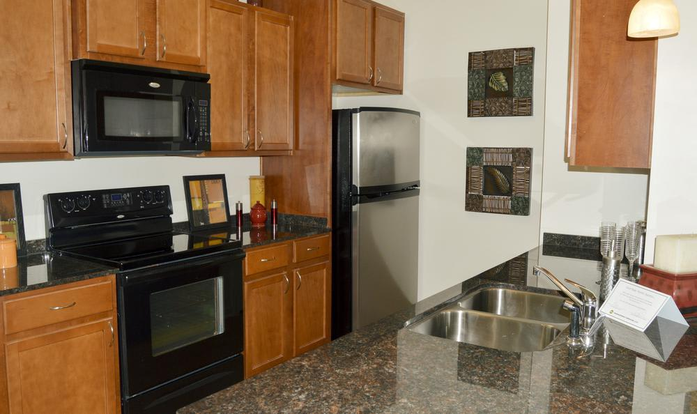 fully equipped kitchen at The Flats at West Broad Village in Glen Allen, VA