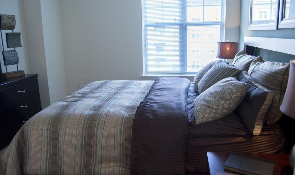 master bedroom at The Flats at West Broad Village in Glen Allen, VA