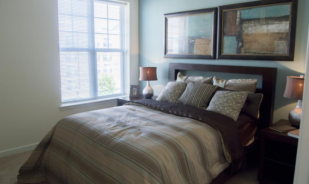 well decorated bedroom at The Flats at West Broad Village in Glen Allen, VA