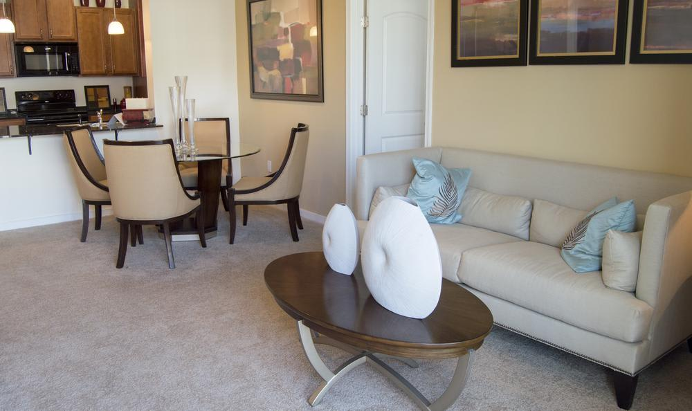well decorated living room at The Flats at West Broad Village in Glen Allen, VA