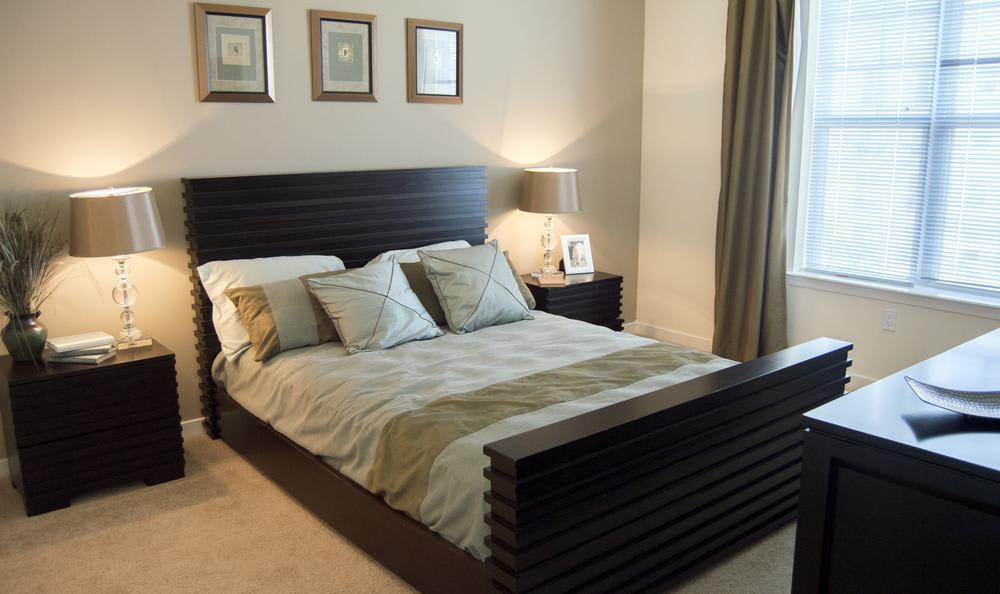 well lit bedroom at The Flats at West Broad Village in Glen Allen, VA