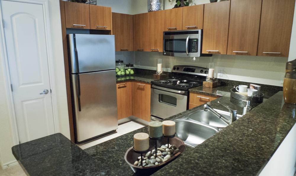 Fully Equipped Kitchen at Elan At Bluffview Apartments in Dallas, TX