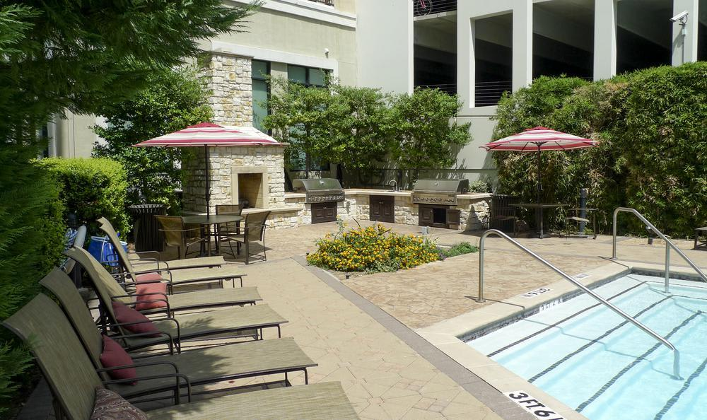 Grilling Area Near Pool at Elan At Bluffview Apartments in Dallas, TX