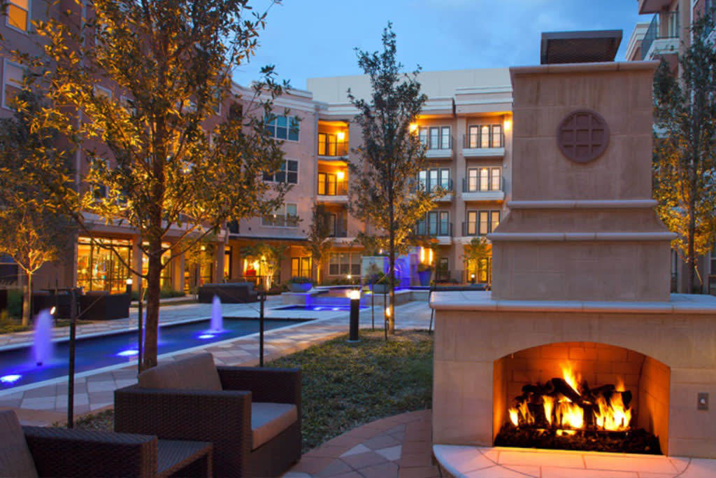 Fire pit near fountains in the evening at Addison Keller Springs in Addison
