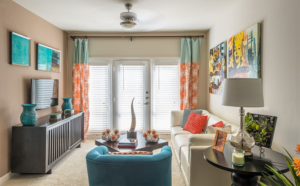 Well-decorated living room in model home at Addison Keller Springs