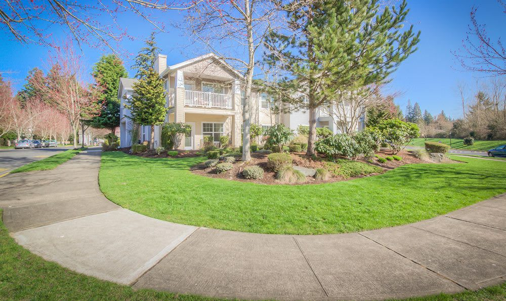 Well-manicured landscaping and resident buildings at Bradley Park Apartments in Puyallup