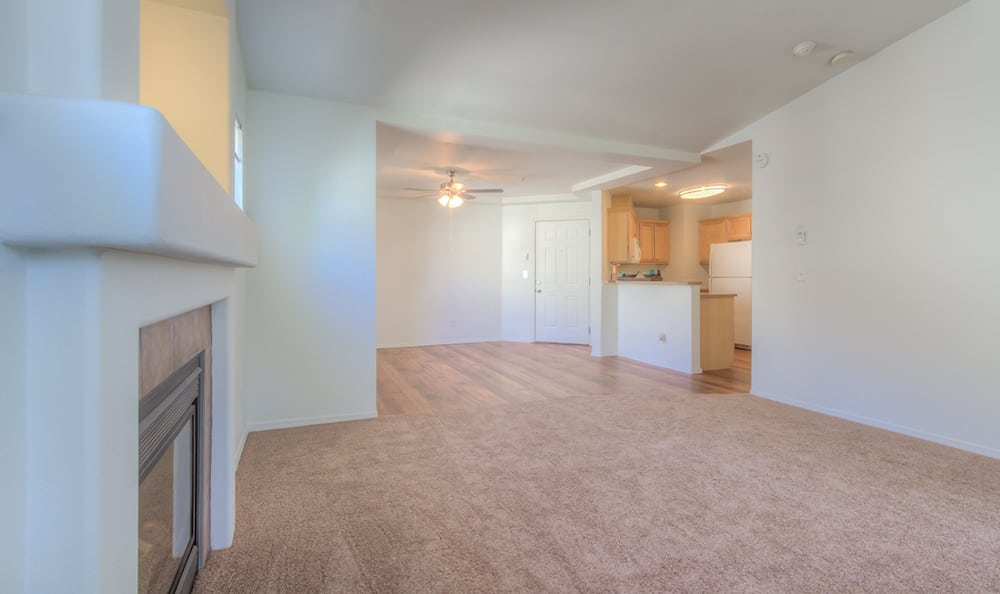 Plush carpeting and hardwood floors in model apartment home at Bradley Park Apartments in Puyallup