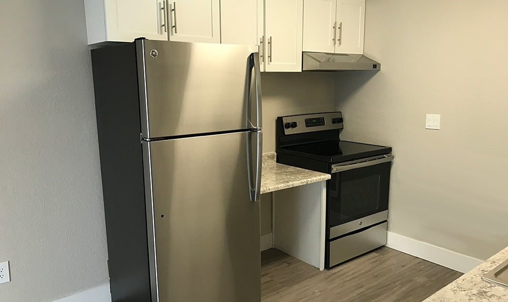 Stainless-steel appliances in kitchen at The Hamptons Apartments