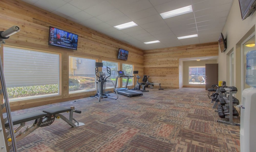 Fully equipped fitness center at The Hamptons Apartments in Puyallup