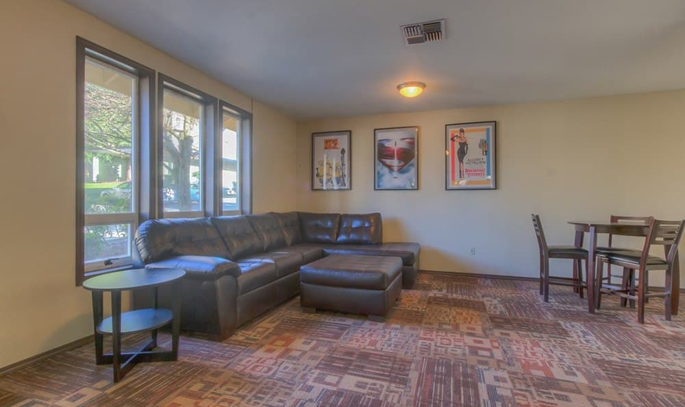 Comfortable clubhouse furniture at The Hamptons Apartments in Puyallup, WA