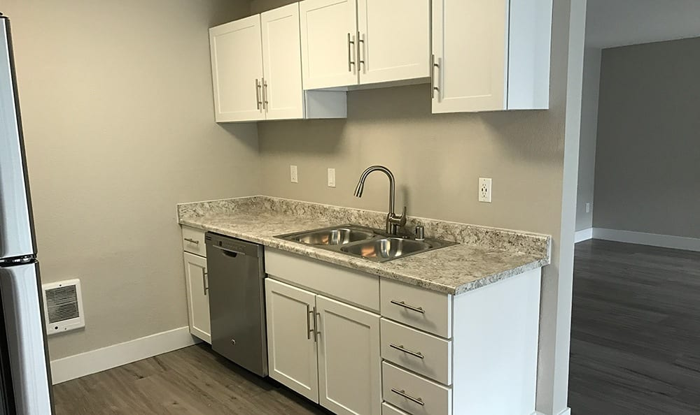 Modern kitchen at The Hamptons Apartments in Puyallup, WA