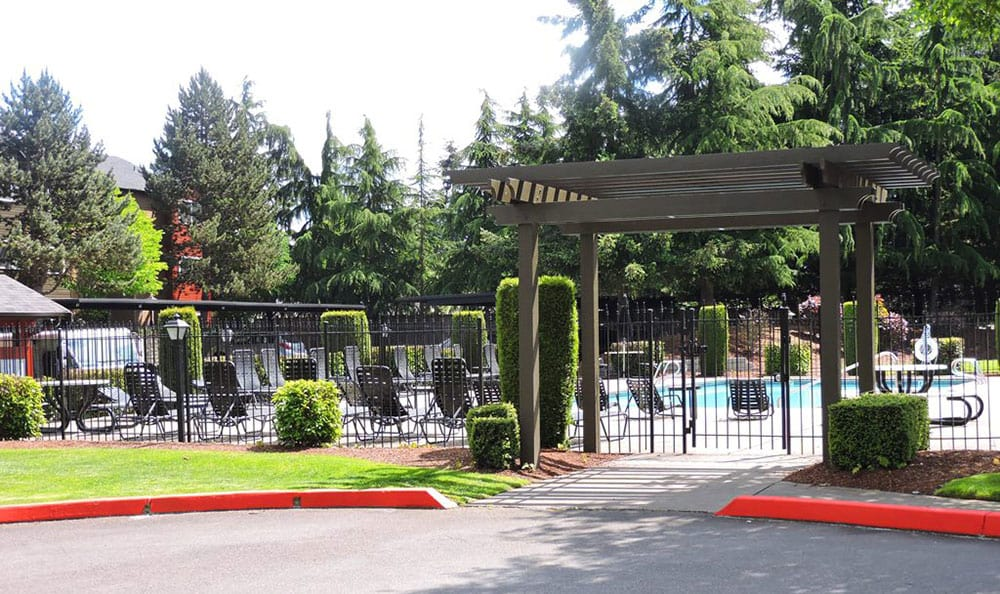 Beautiful pergola serves as the entrance to the Village at Seeley Lake swimming pool area in Lakewood