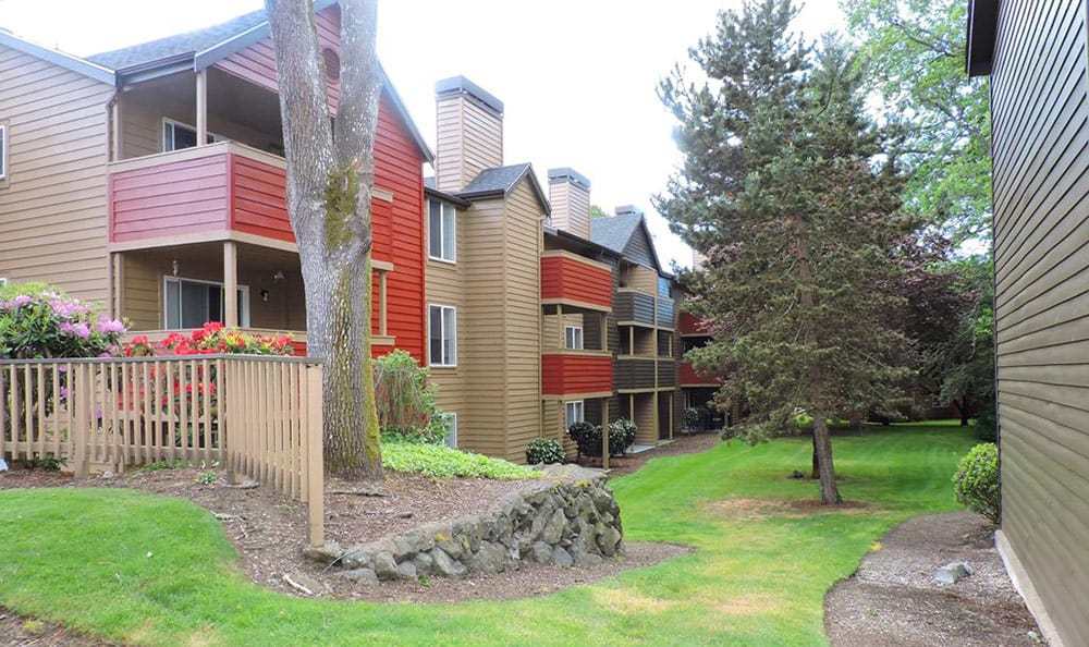Well-manicured landscaping surround resident buildings at Village at Seeley Lake in Lakewood