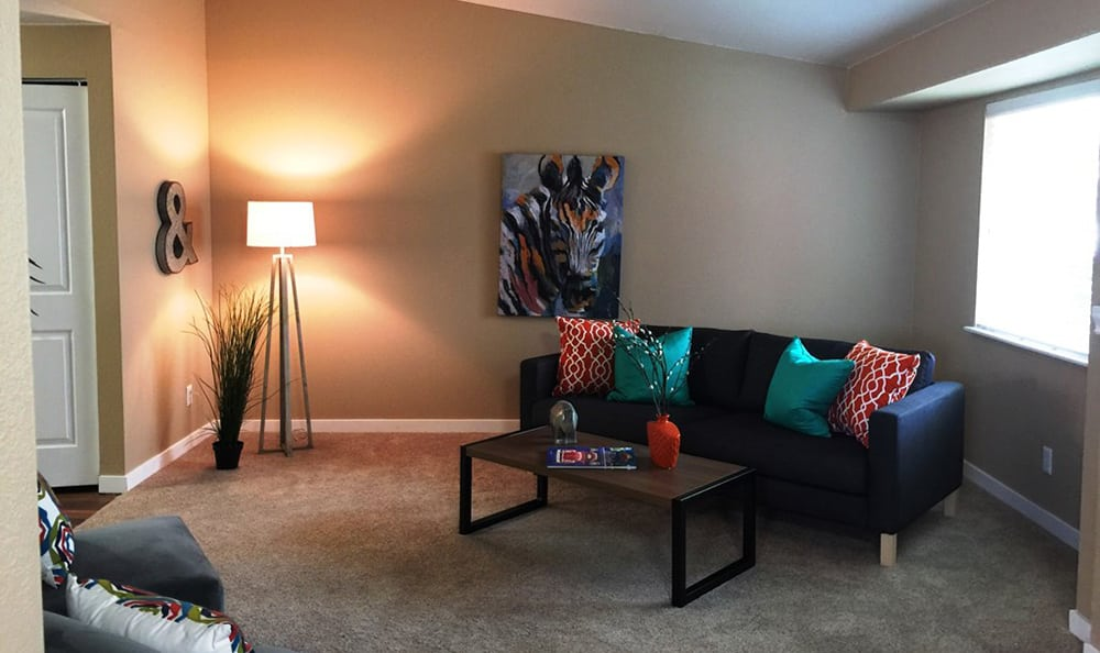 Well-decorated living room in model home at Village at Seeley Lake in Lakewood