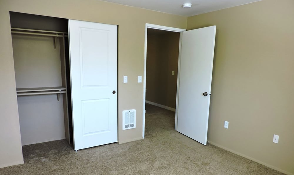 Empty bedroom at Village at Seeley Lake in Lakewood, WA, showcasing the spacious floor plan