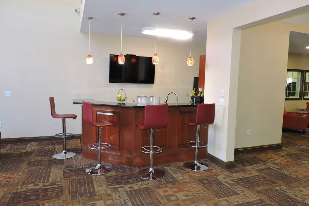 View of the bar in the clubhouse at Village at Seeley Lake in Lakewood