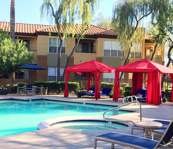 Beautiful swimming pool and shaded cabanas at The Retreat Apartments