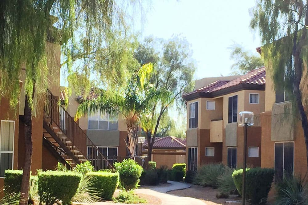 Resident buildings exterior, showcasing beautiful and well-maintained landscaping at The Retreat Apartments in Phoenix, Arizona