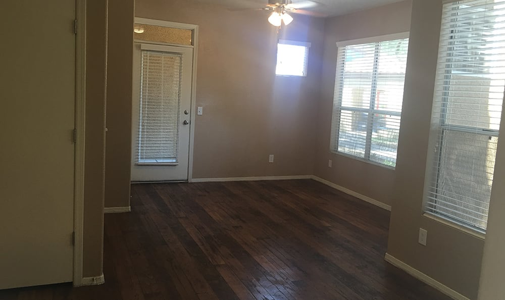 Hardwood floors and large windows letting plenty of natural light in at The Retreat Apartments in Phoenix