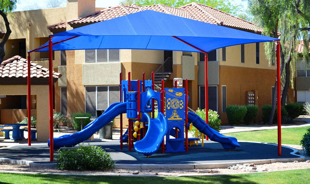 On-site playground near tenant buildings at The Retreat Apartments in Phoenix