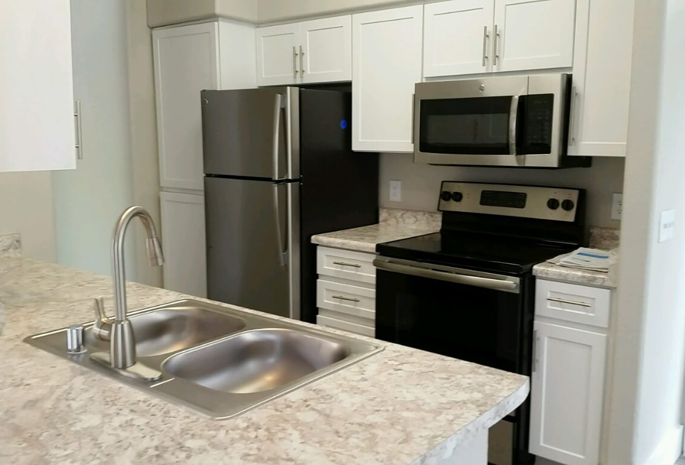Modern and well-equipped kitchen in model home at The Retreat Apartments