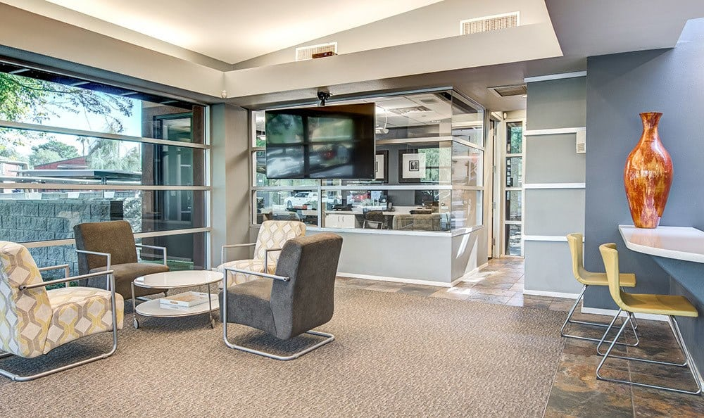Another view of seating areas in the well-decorated leasing office at Aventerra at Dobson Ranch in Mesa