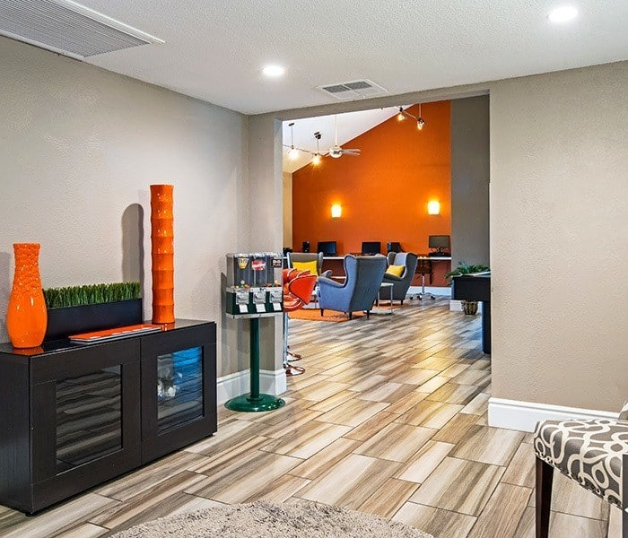 Hardwood floors and contemporary furniture in clubhouse at Villetta Apartments in Mesa, Arizona