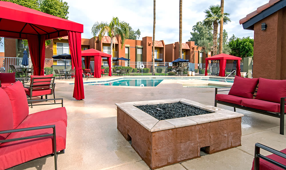 View of pool from private poolside cabanas at Villetta Apartments in Mesa
