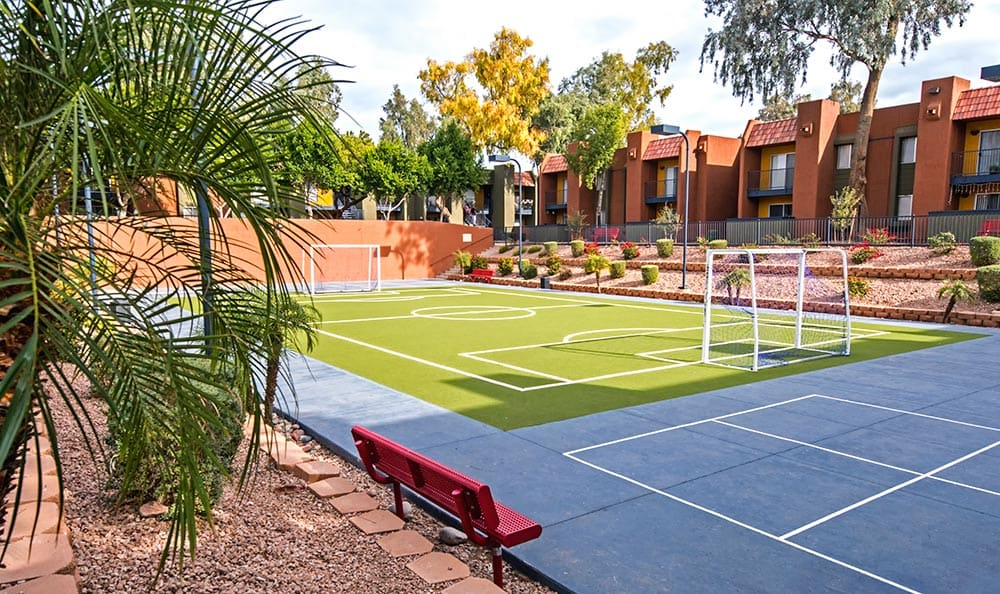 Wide-angle view of the soccer field at Villetta Apartments in Mesa