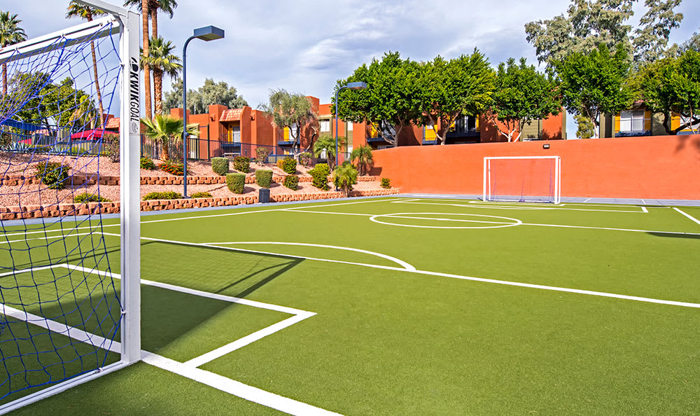 Long view of the soccer field, from goal to goal, at Villetta Apartments in Mesa
