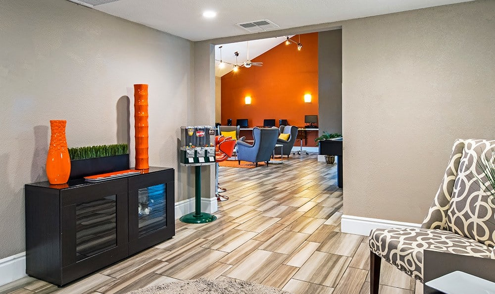 Beautifully decorated clubhouse at Villetta Apartments in Mesa, showcasing hardwood floors and avant garde furnishings