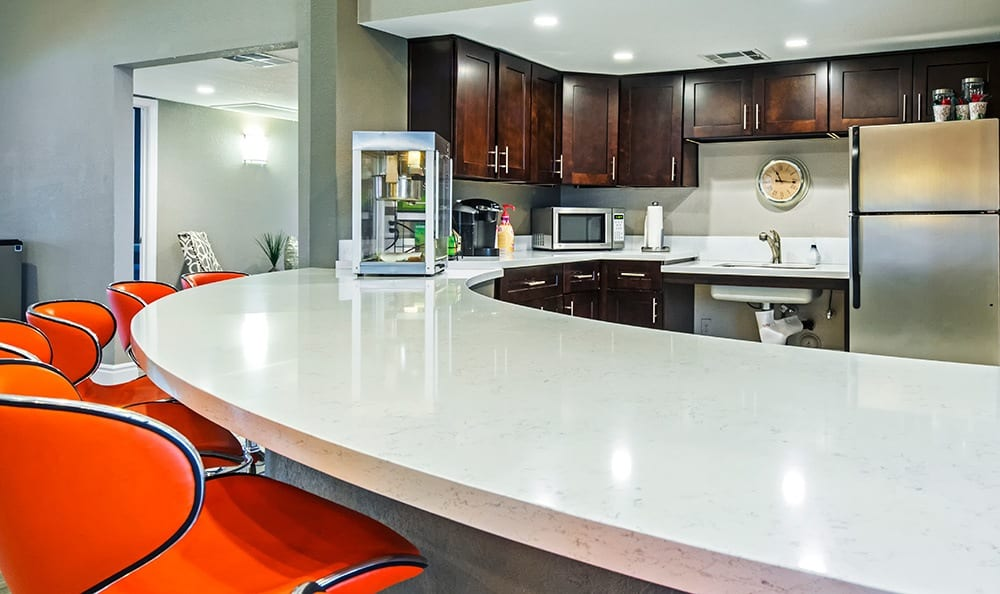 Bar and kitchen area in the clubhouse at Villetta Apartments in Mesa