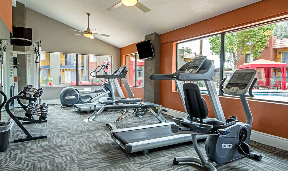 Fully equipped fitness center at Villetta Apartments in Mesa includes treadmills and more