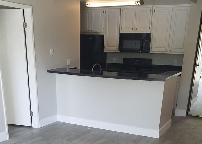 Redesigned kitchen and hardwood floors at Presidio at Rancho Del Oro in Oceanside, California