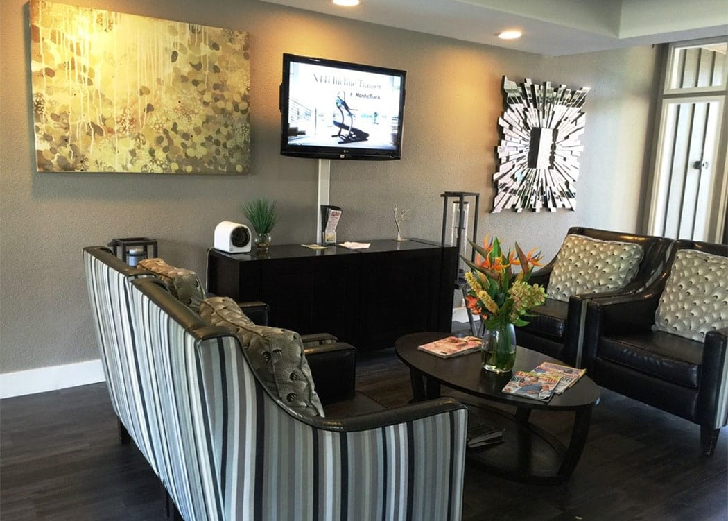 Flatscreen TV and comfortable seating in the Presidio at Rancho Del Oro leasing office in Oceanside