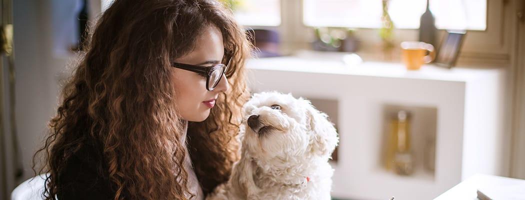 Resident and her dog at Presidio at Rancho Del Oro