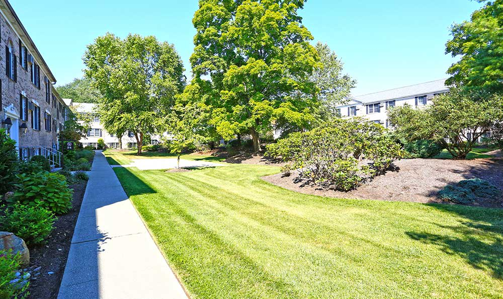 A pleasant walking path at Coventry Square Apartments.