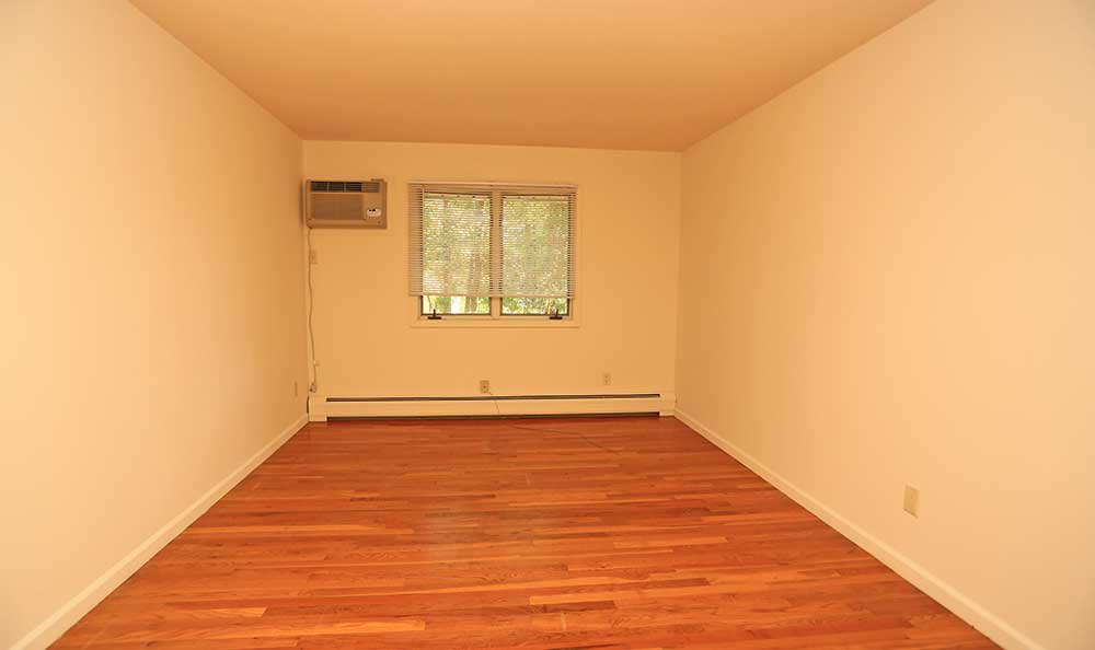 A large and clean room at The Madison Apartments